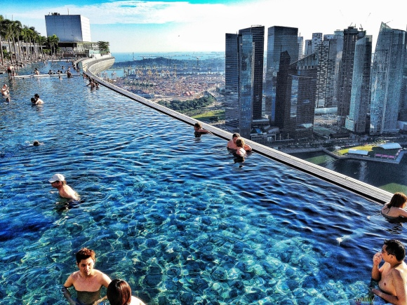 The infinity pool at the Marina Bay Sands in Singapore is the longest elevated pool in the world. Photo by Flickr user Luca Sartoni.
